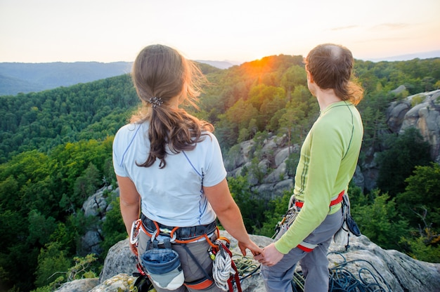 Couple of climbers resting and enjoying beautiful nature view Premium Photo