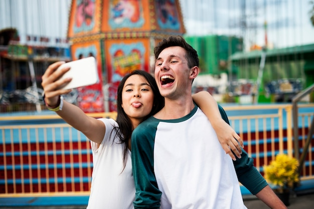 Couple dating relaxation love theme park concept Free Photo