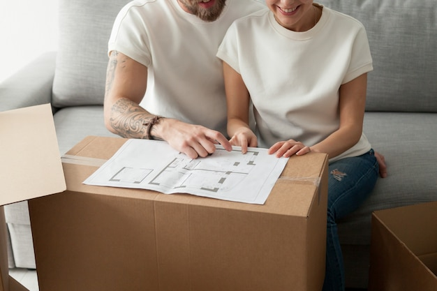 Couple discussing house plan, moving in new home, planning renovation Free Photo