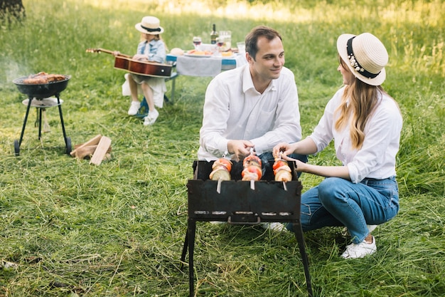 Couple doing a barbecue in nature Free Photo