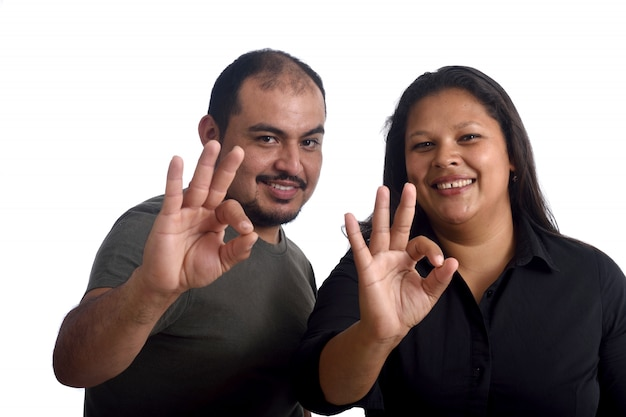 Couple doing the ok sign on white Premium Photo
