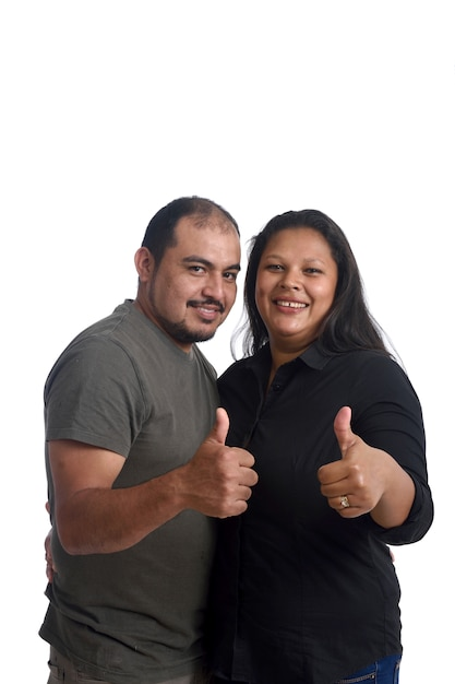 Couple doing the sign thumbs up on white background Premium Photo