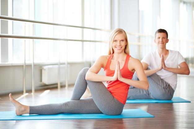 Couple doing yoga Free Photo
