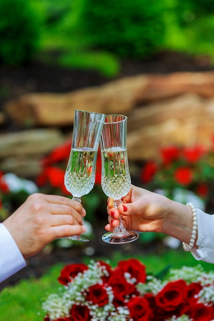 The couple drinking champagne in the park Premium Photo