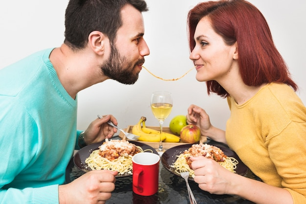 Couple eating noodle together Free Photo