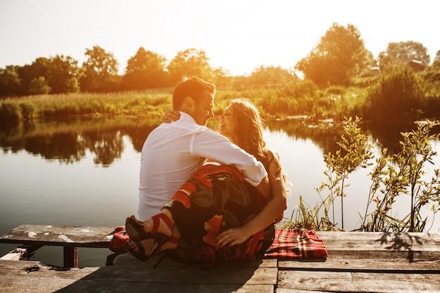 Free Photo | Couple embracing looking at a lake