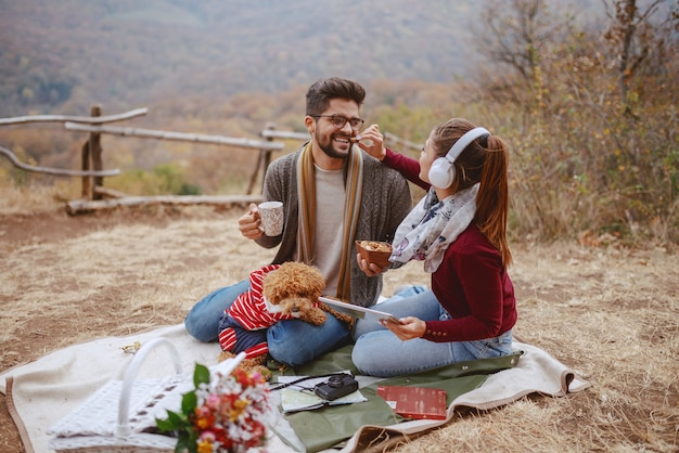 Couple enjoying picnic at autumn Premium Photo
