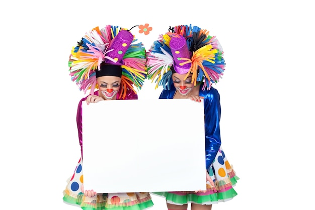 Couple of funny clowns with a blank poster isolated on white background Premium Photo