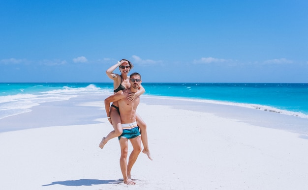 Couple happy together on a vacation by the ocean Free Photo
