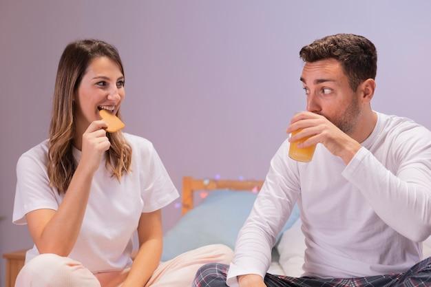 Couple having breakfast in bed Free Photo