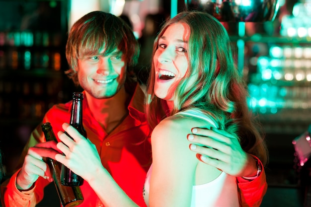 Couple having drinks in bar or club Premium Photo