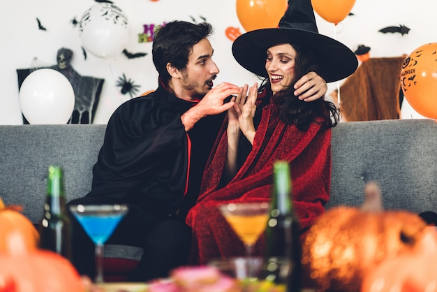 Couple having fun holding pumpkins and wearing dressed carnival halloween costumes Premium Photo