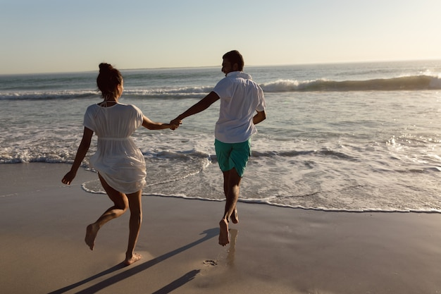 Couple having fun together on the beach Free Photo