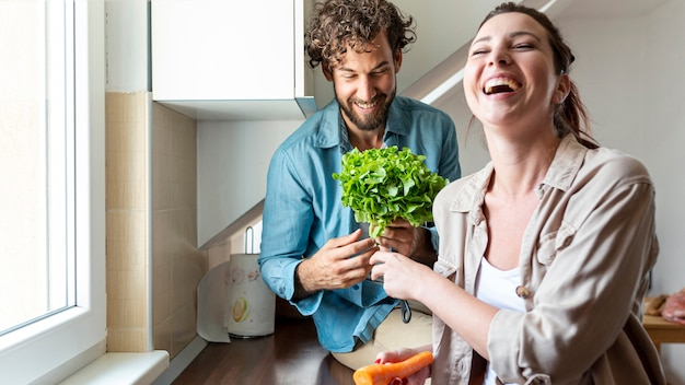 Couple having fun while cooking dinner Free Photo