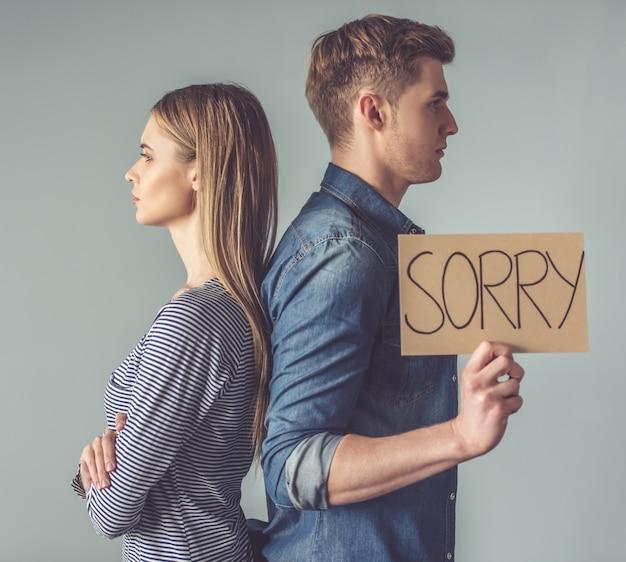 Couple having a quarrel, standing back to back. Premium Photo