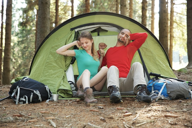 Couple of hikers rest in tent Premium Photo