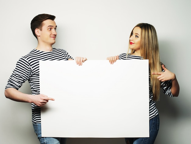 Couple holding a banner - isolated over a white background Premium Photo