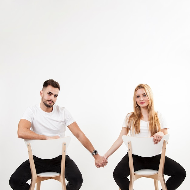 Couple holding hands and looking at camera 23 2147737257
