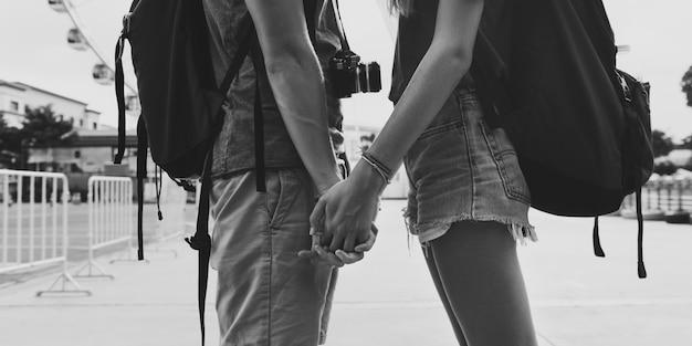 Couple holding hands park background Premium Photo