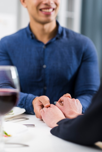 Couple holding hands on table Free Photo