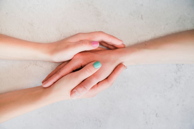 Couple holding hands together Free Photo
