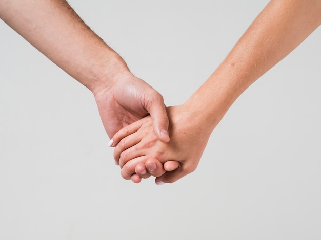 Couple holding hands for valentines day Free Photo