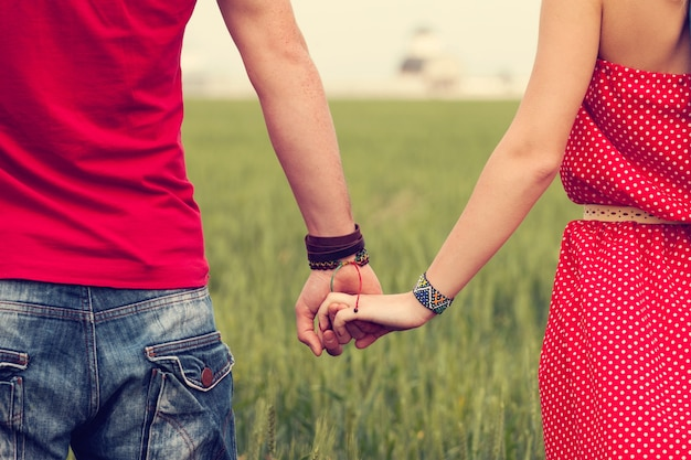 Couple holding hands Free Photo