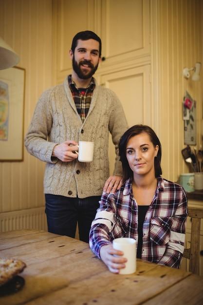 Couple holding mug of coffee Free Photo