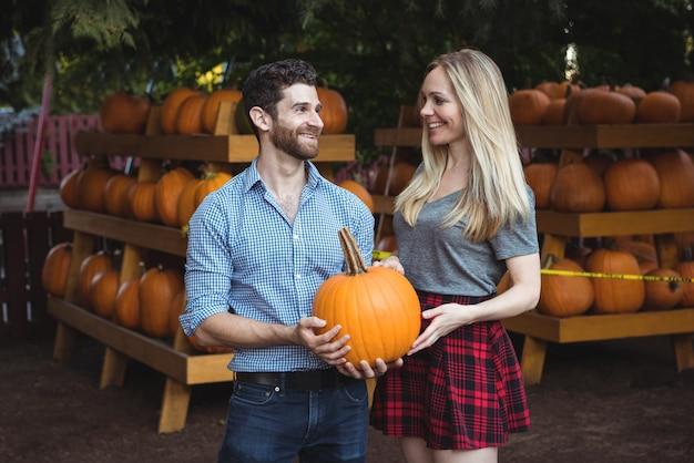 Couple holding pumpkin Free Photo