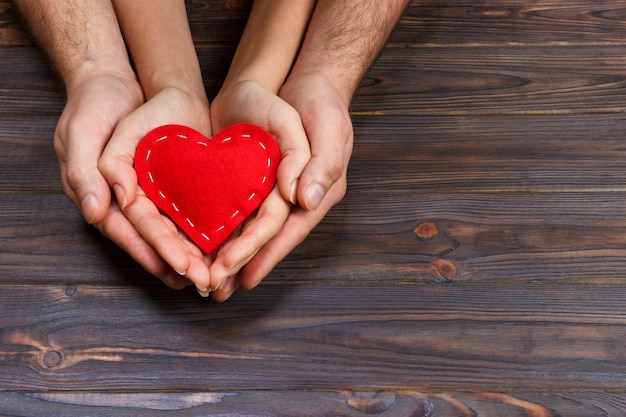 Couple holding red heart Premium Photo