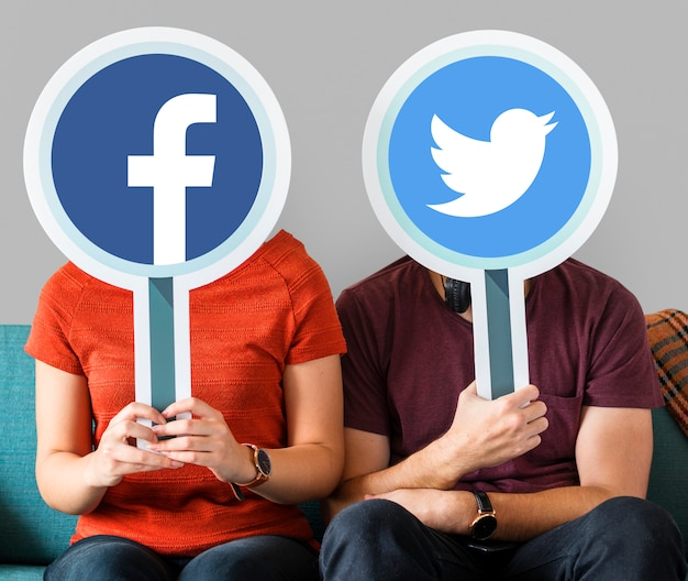 Couple holding social media icons Free Photo
