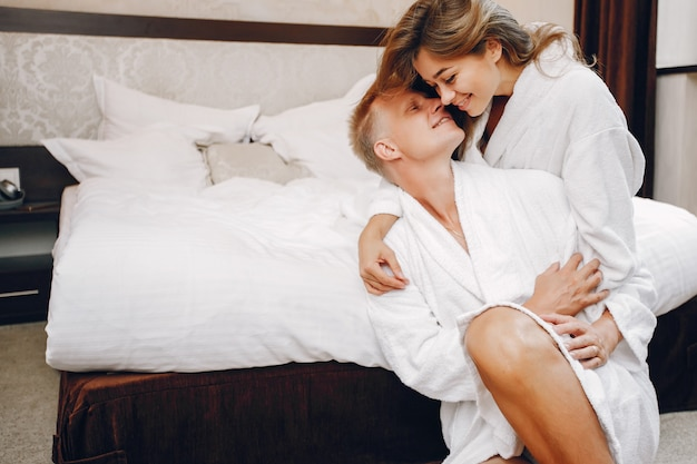 Couple in a hotel Free Photo