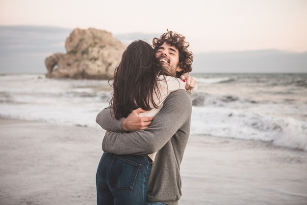 Couple hugging with lots of energy Free Photo
