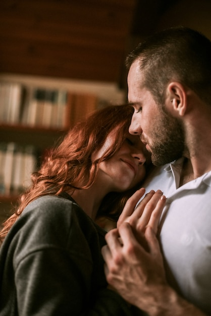 Couple hugging in wooden house Premium Photo