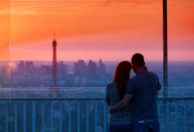 Couple in love admiring the Eiffel tower Free Photo