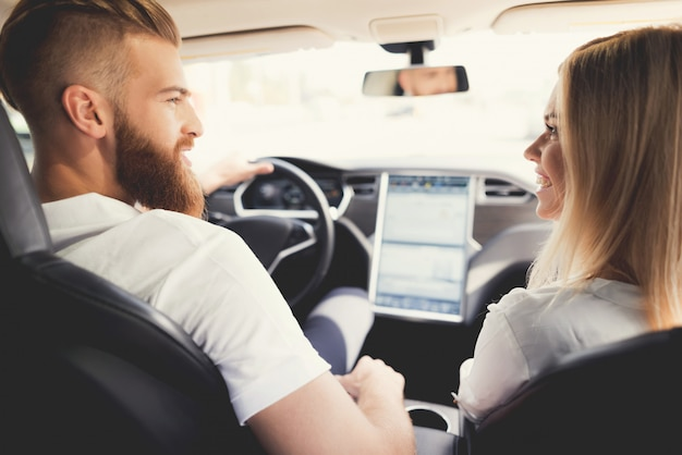 Couple is sitting in comfortable modern electric car. Premium Photo