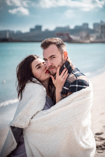 Couple is standing on the beach and posing Free Photo