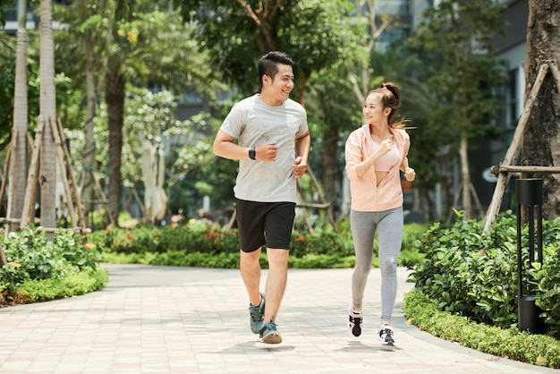 Couple jogging in park Free Photo