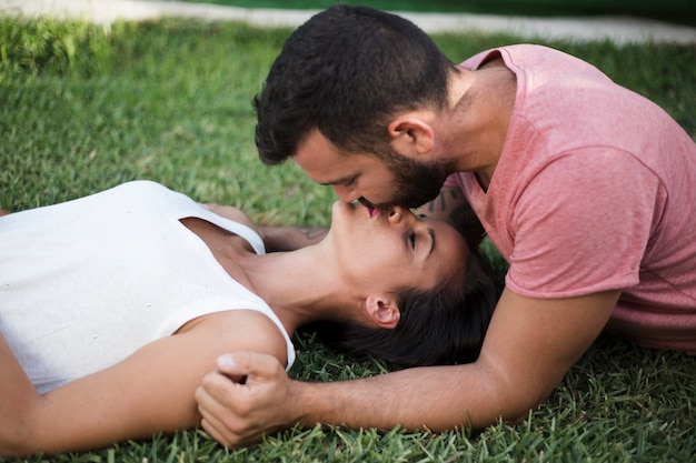 Couple kissing each other in park Free Photo
