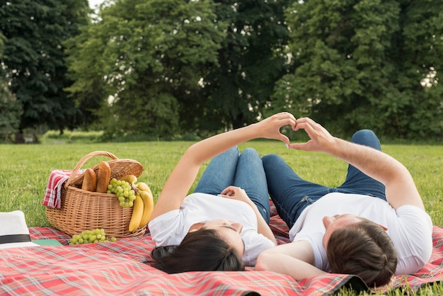 Couple laying on a picnic blanket Free Photo