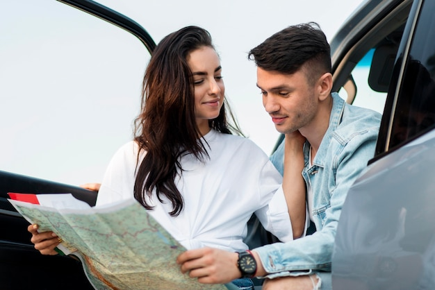 Couple looking on a map together medium shot Free Photo