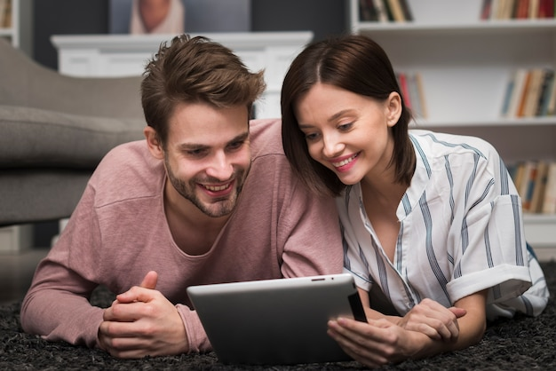 Couple looking at tablet Free Photo
