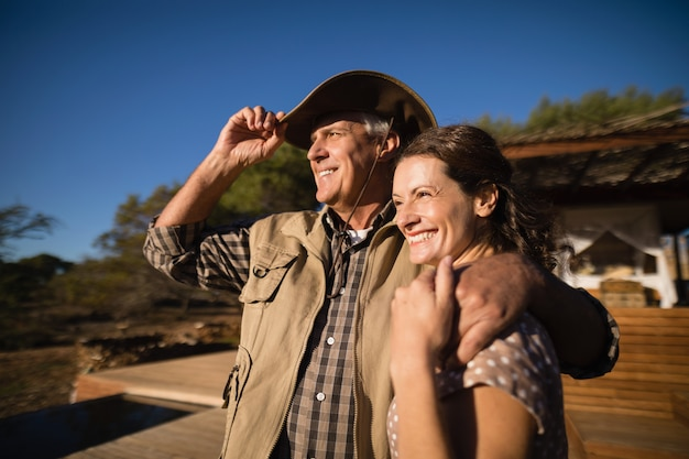Couple looking at view during safari vacation Free Photo