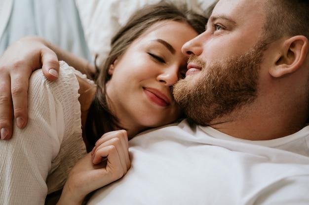 Couple in love in the bedroom. slender brunette. stylish interior. Premium Photo