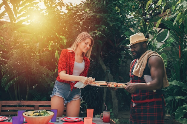 Couple in love having a barbecue party in nature. barbecue and party. Premium Photo