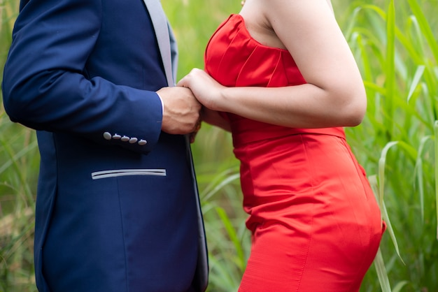 Couple in love holding hands together on  outdoor Premium Photo