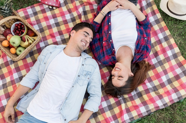 Couple lying on a picnic blanket top view Free Photo