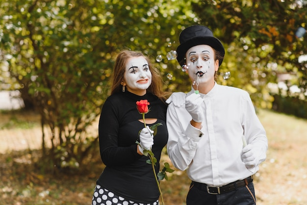 A couple of merry mimes. Premium Photo