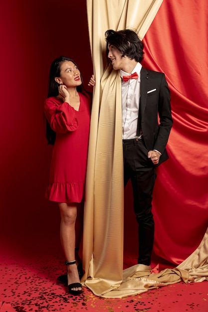 Couple posing looking at each other for new chinese year Free Photo