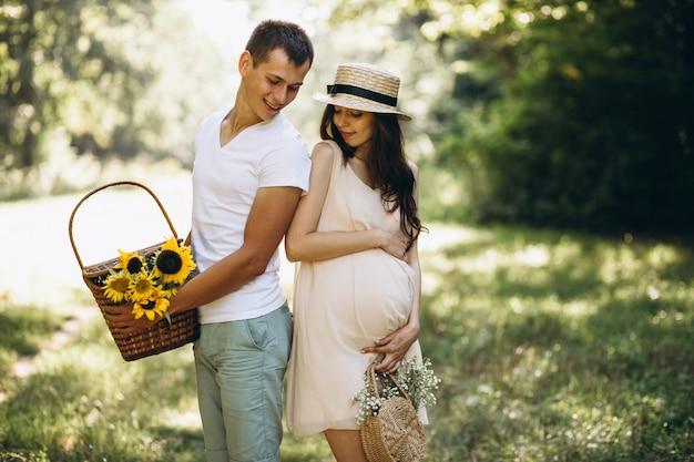 Couple pregnant, having picnic in park Free Photo